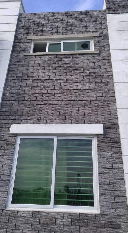 Black outdoor front wall house face stone tiles design in pakistan